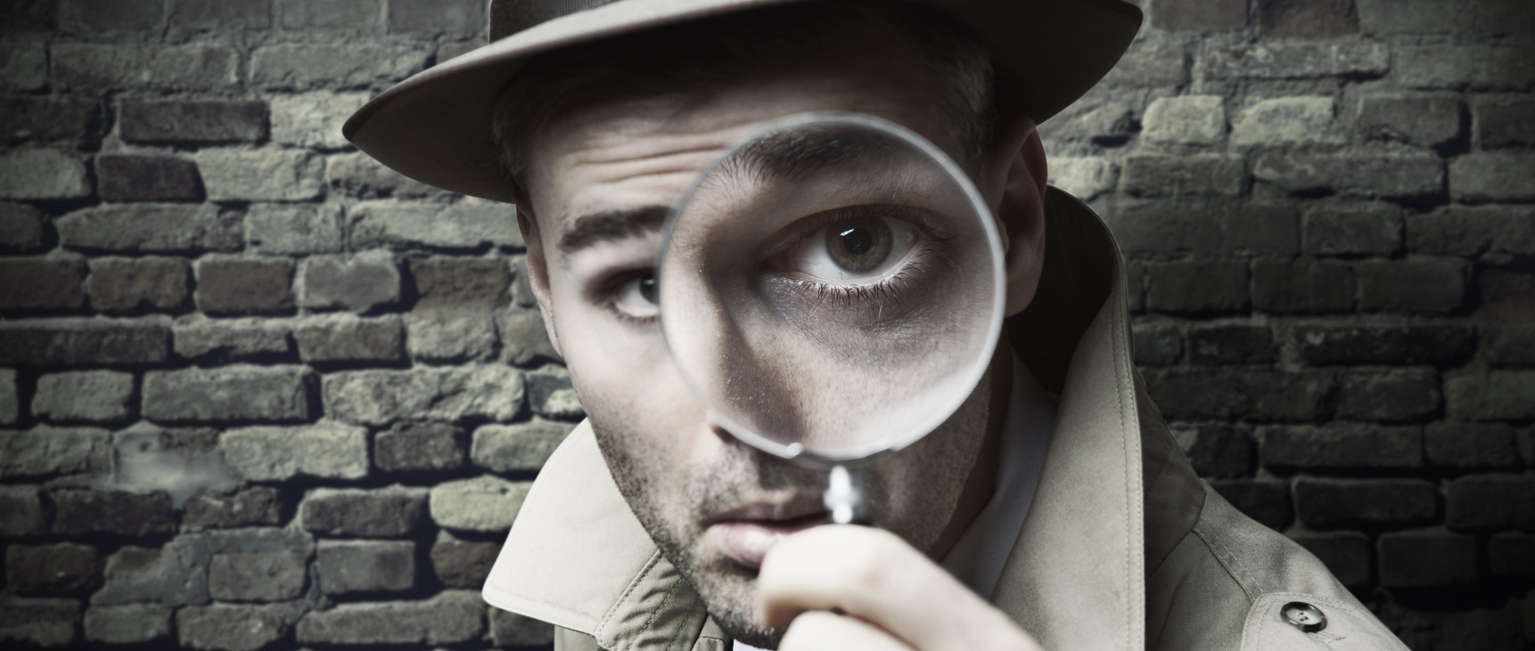 Detective looking through a magnifier